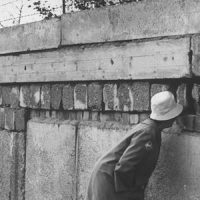 Woman looking through a hole in the Berlin Wall.  (Photo by Robert Lackenbach//Time Life Pictures/Getty Images)