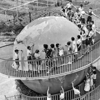 Children at a school in France have a huge globe which they can walk around on a spiral staircase.